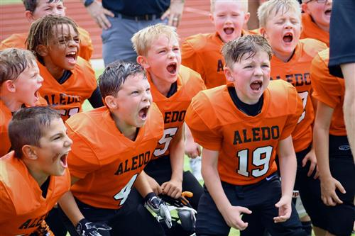 Young Aledo football players celebrate